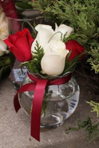 The deep red and pristine white combined with winter greenery would accent a December wedding perfectly.